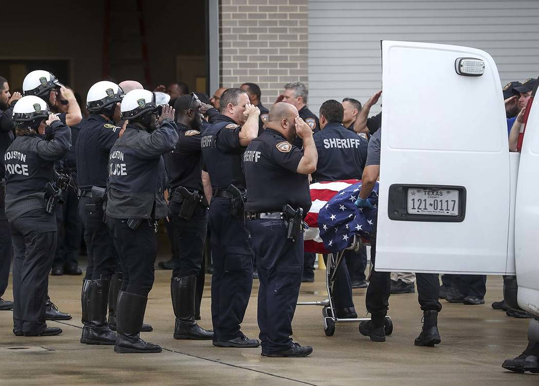 Law enforcement officers escort the body of Deputy Sandeep Dhaliwal, who was shot and killed af ...