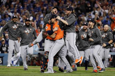 The Houston Astros celebrate after Game 7 of baseball's World Series against the Los Angeles Do ...