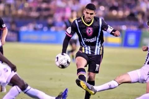Irvin Parra, center, shown earlier this season, had two goals and an assist Saturday in Lights ...