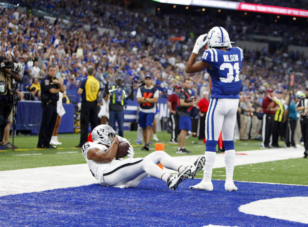 Oakland Raiders wide receiver Tyrell Williams (16) scores a touchdown as Indianapolis Colts cor ...