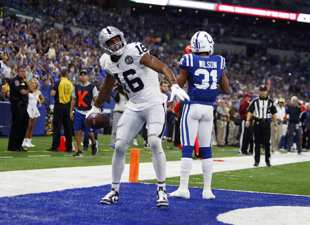 Oakland Raiders wide receiver Tyrell Williams (16) celebrates a touchdown score as defender Ind ...