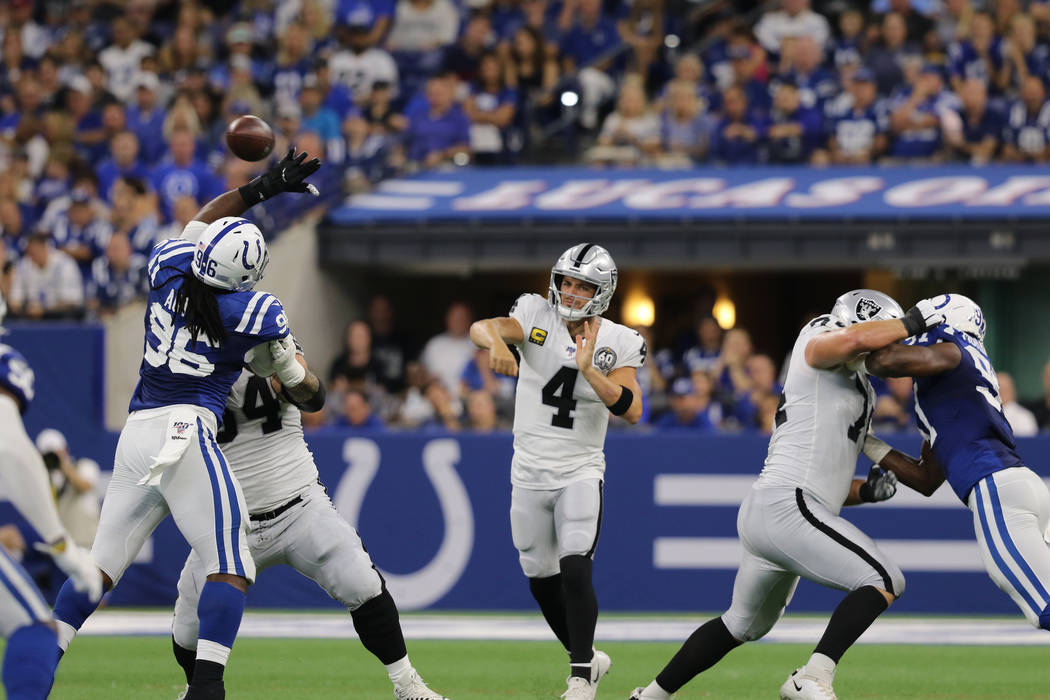 Oakland Raiders quarterback Derek Carr (4) throws the football over Indianapolis Colts defensiv ...