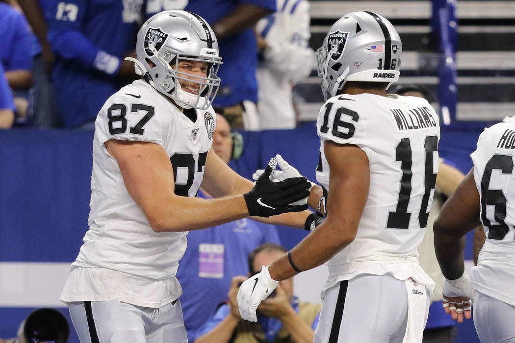 Oakland Raiders tight end Foster Moreau (87) celebrates his touchdown with wide receiver Tyrell ...