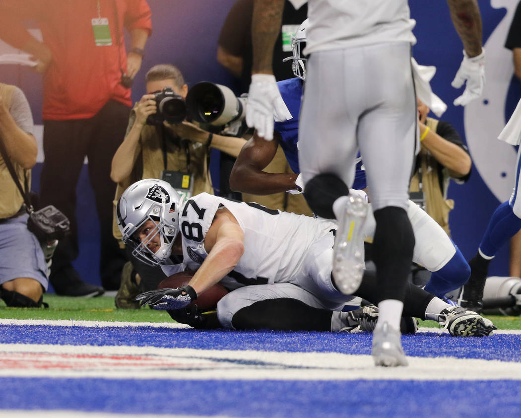 Oakland Raiders tight end Foster Moreau (87) scores a touchdown eduring the first half of an NF ...