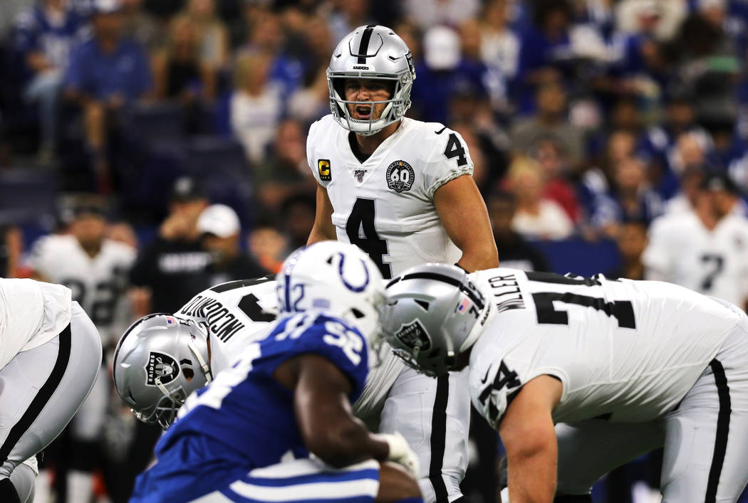 Oakland Raiders quarterback Derek Carr (4) calls an audible at the line of scrimmage during the ...