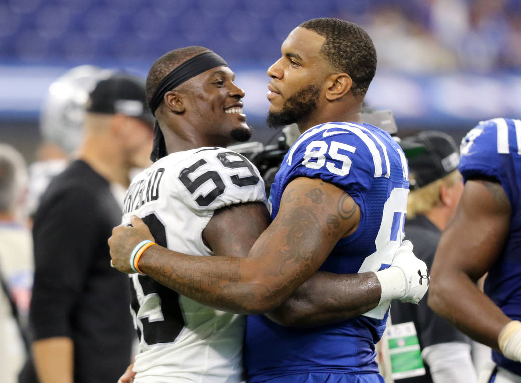 Oakland Raiders outside linebacker Tahir Whitehead (59) and Indianapolis Colts tight end Eric E ...
