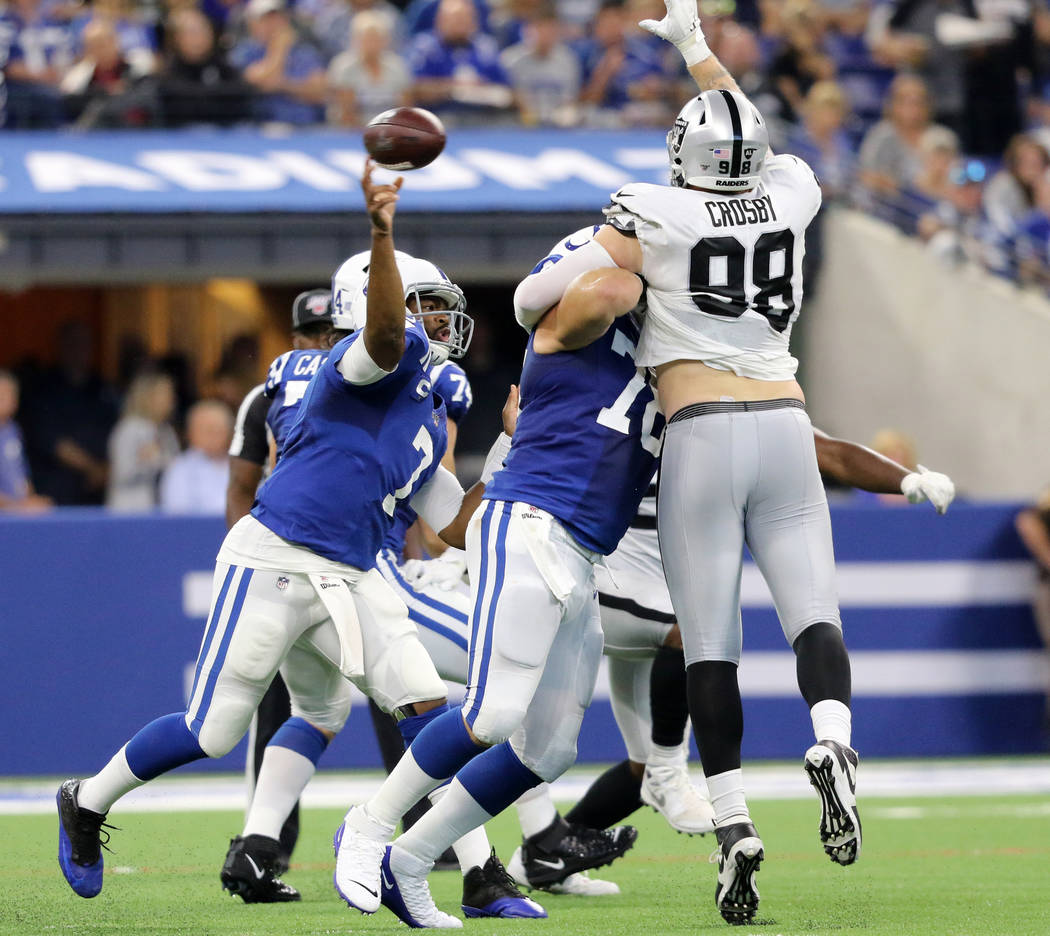 Oakland Raiders defensive end Maxx Crosby (98) jumps to deflect a football thrown by Indianapol ...
