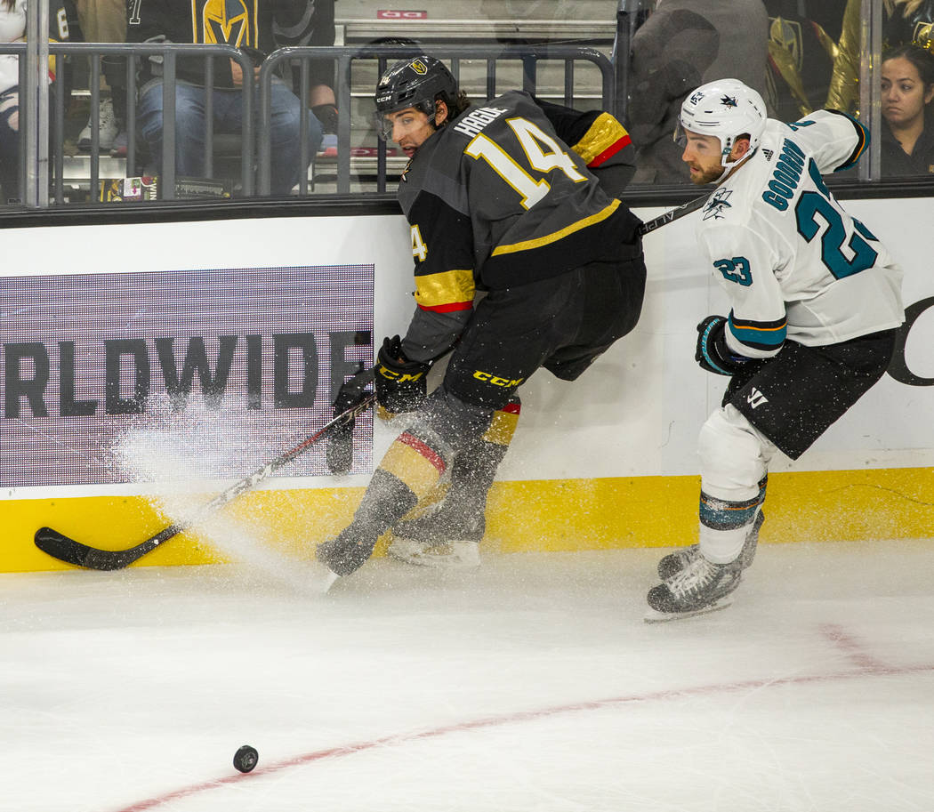 Vegas Golden Knights defenseman Nicolas Hague (14) skates to a stop beside San Jose Sharks righ ...