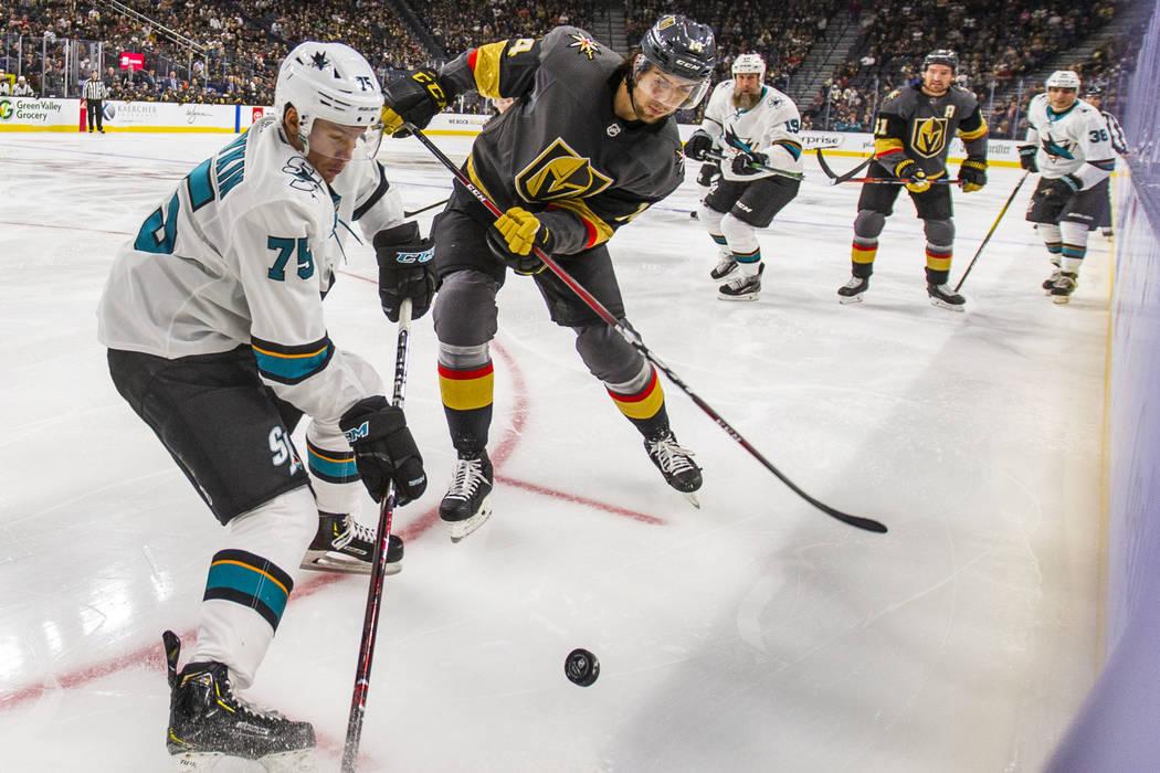 San Jose Sharks left wing Danil Yurtaykin (75) battles for control of the puck with Vegas Golde ...