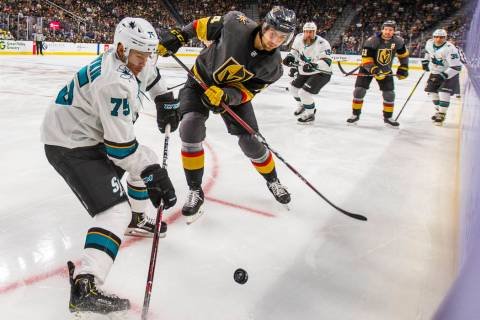 San Jose Sharks left wing Danil Yurtaykin (75) battles for control of the puck with Vegas Golde ...