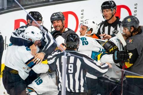 Vegas Golden Knights Deryk Engelland (5), center, fights with San Jose Sharks Timo Meier (28), ...