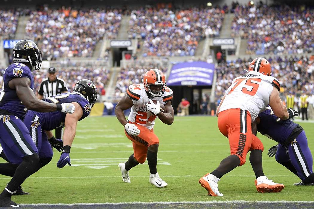 Cleveland Browns running back Nick Chubb (24) runs for one of his three rushing touchdowns agai ...