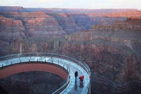 Workers from Highland Glass Products Inc. inspect The Skywalk at Grand Canyon West before under ...