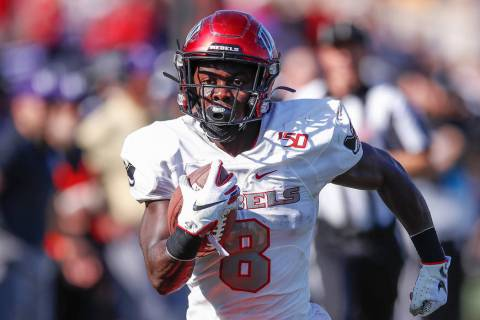 UNLV Rebels running back Charles Williams runs to score a touchdown against the Northwestern Wi ...