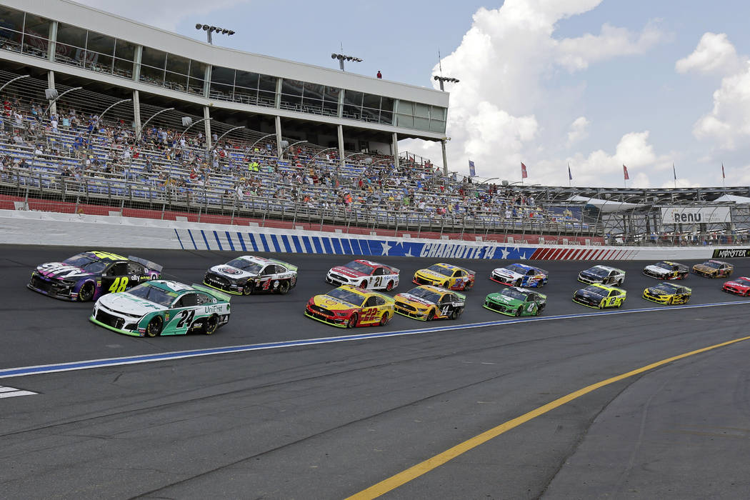 William Byron (24) and Jimmie Johnson (48) lead the field of cars through Turn 4 to start a NAS ...