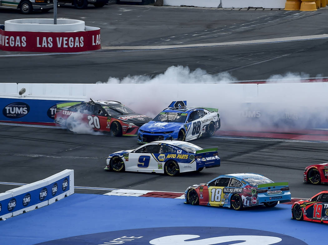 Erik Jones (20) and Alex Bowman (88) spin during the NASCAR Cup Series auto race at Charlotte M ...
