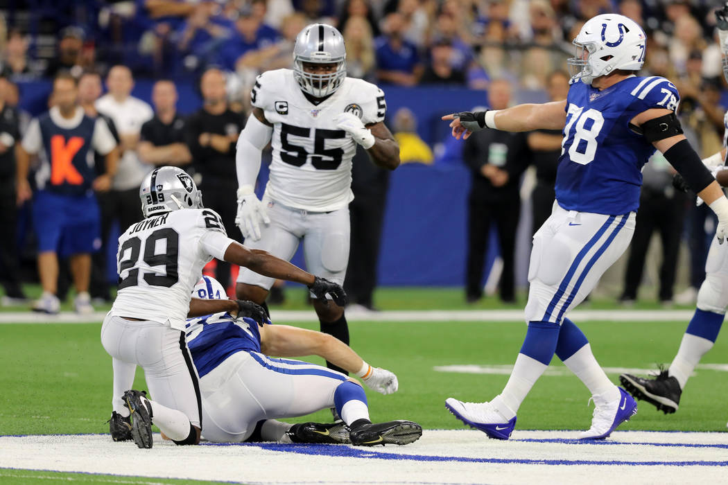 Indianapolis Colts center Ryan Kelly (78) points to Oakland Raiders outside linebacker Vontaze ...
