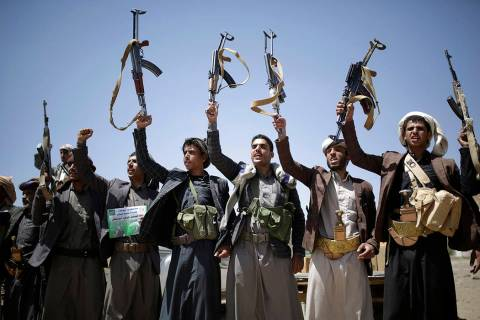 FILE - In this Sept. 21, 2019 file photo, Shiite Houthi tribesmen hold their weapons as they ch ...