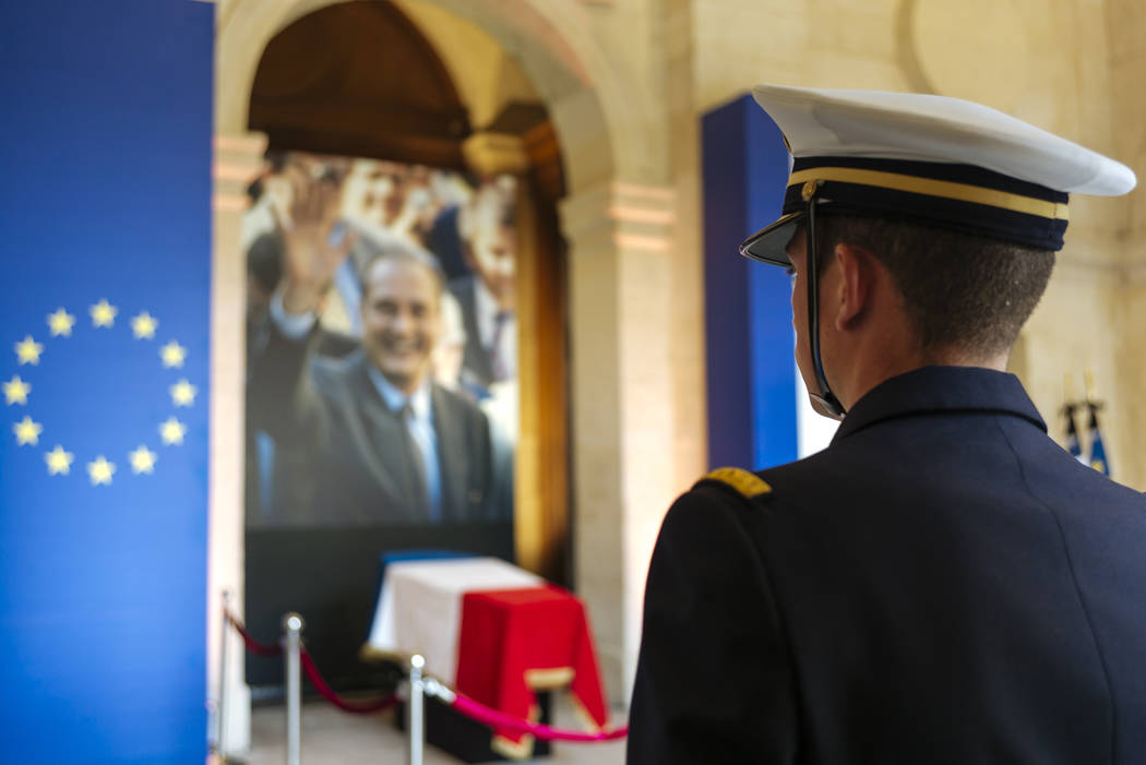 A military officer stands guard in front of the coffin of late French President Jacques Chirac, ...