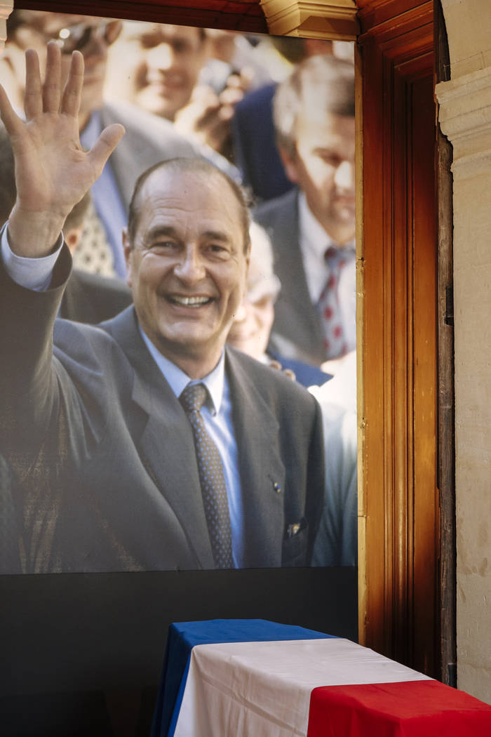 The coffin of former French President Jacques Chirac is seen Sunday, Sept. 29, 2019 at the Inva ...