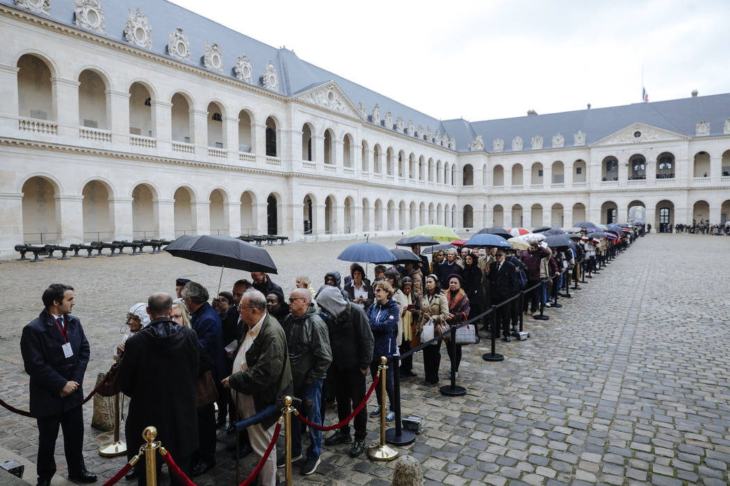 Visitors queue to pay their respects to former French President Jacques Chirac, Sunday, Sept. 2 ...
