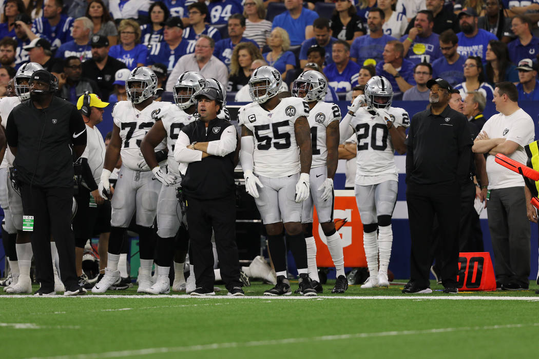 Oakland Raiders outside linebacker Vontaze Burfict (55) stands on the sideline to the right of ...