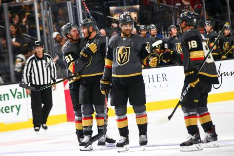 Golden Knights' Max Pacioretty, third from left, celebrates his goal with Nate Schmidt (88) alo ...