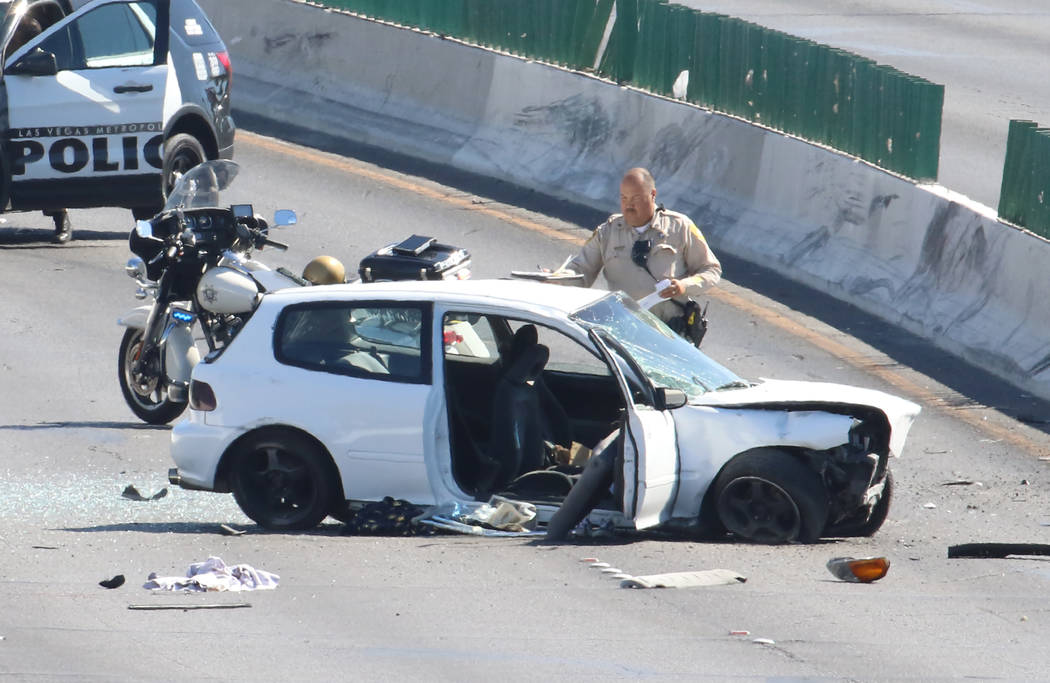 Las Vegas police investigate a crash where two people were critically injured at Desert Inn Roa ...