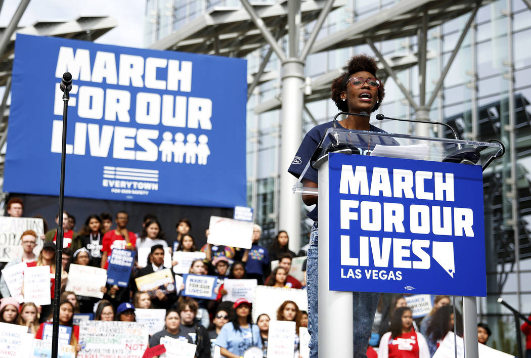 Denise Hooks, 26, addresses the crowd during the Las Vegas March for Our Lives event at Symphon ...