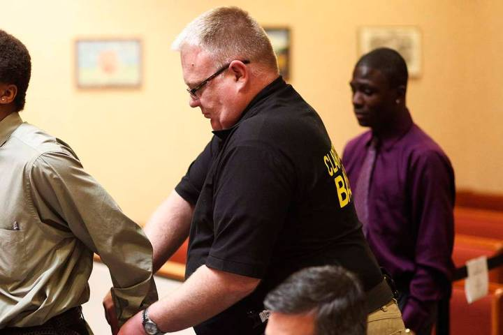 Bailiff Jered Pace, center, removes handcuffs from a defendant in North Las Vegas Justice Court ...
