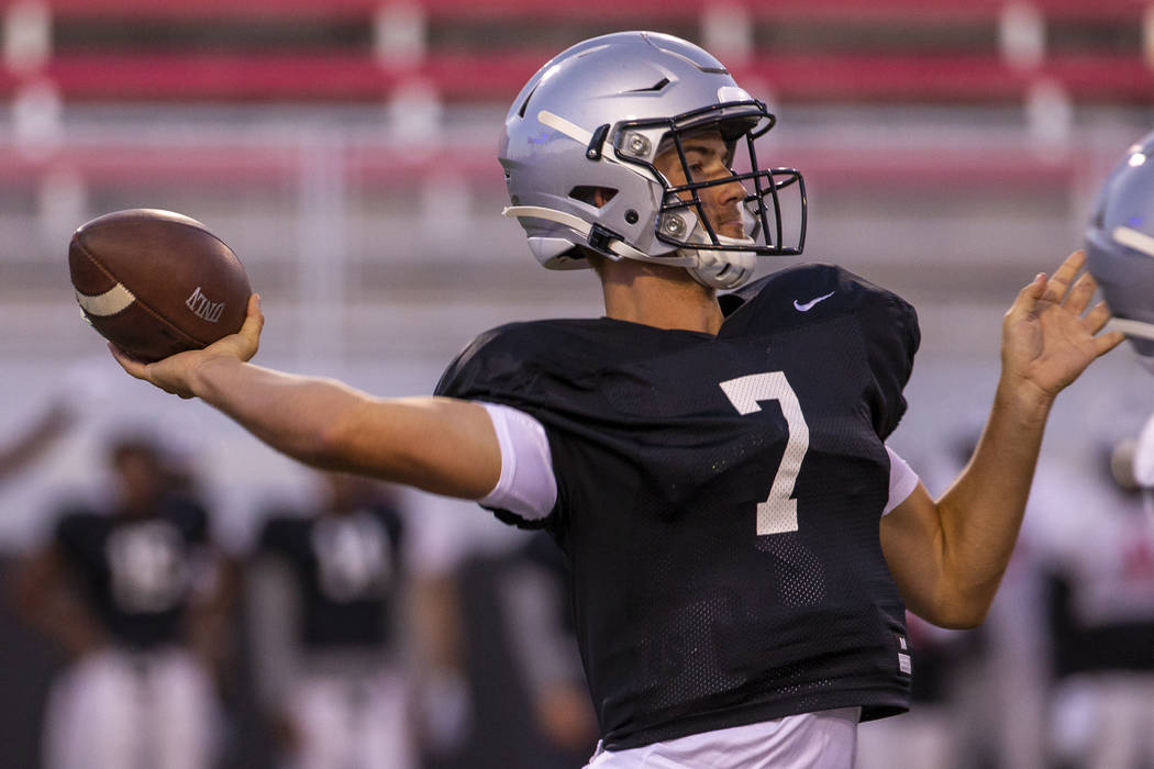 QB Kenyon Oblad (7) looks to a receiver during the UNLV football team scrimmage at Sam Boyd Sta ...