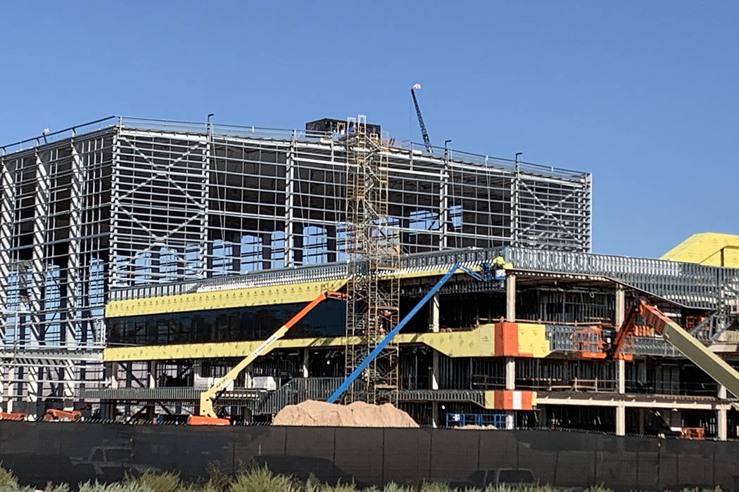 Glass installation progresses on the Raiders Henderson headquarters and practice facility, seen ...