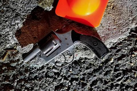 In this photo provided by the New York City Police Department, a hand gun recovered at the scen ...