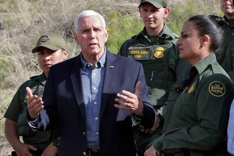 FILE--Vice President Mike Pence speaks along the International border while meeting with border ...
