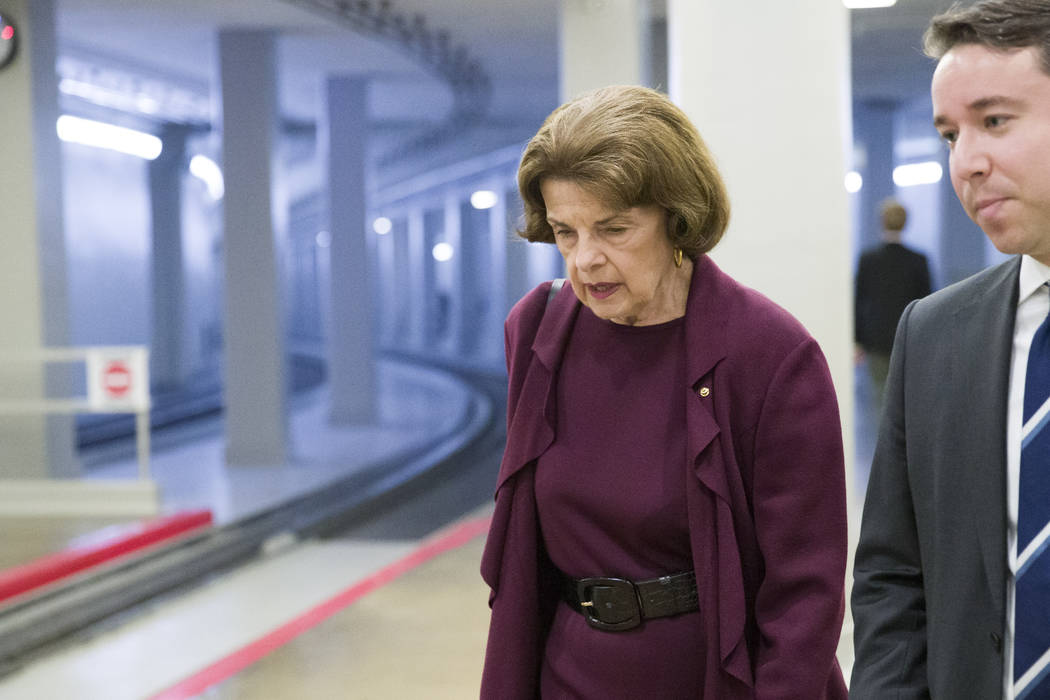 Sen. Dianne Feinstein, D-Calif., left, heads to the Senate for a vote, on Capitol Hill, Tuesday ...