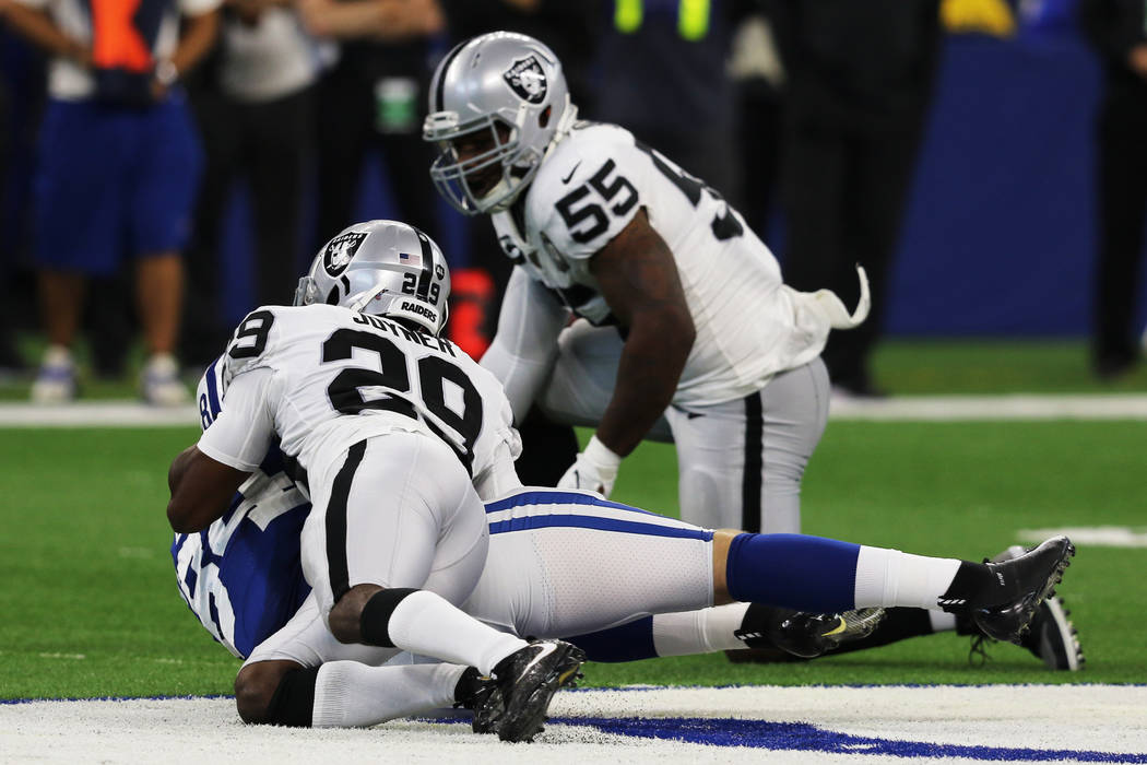 Oakland Raiders outside linebacker Vontaze Burfict (55) stands after tackling Indianapolis Colt ...