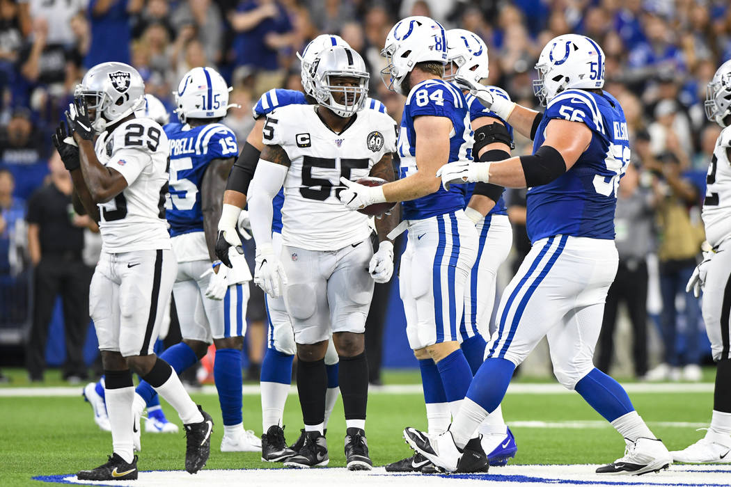 Oakland Raiders outside linebacker Vontaze Burfict (55) speaks with Indianapolis Colts tight en ...