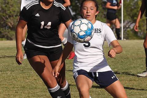 Centennial High School's Viviana Cera (5) pushes past a Palo Verde High School player during a ...