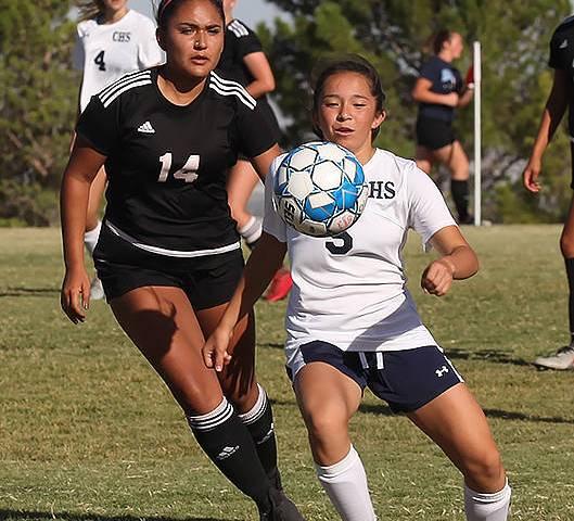 Centennial High School's Viviana Cera (5) pushes past a Palo Verde High School player during a ...