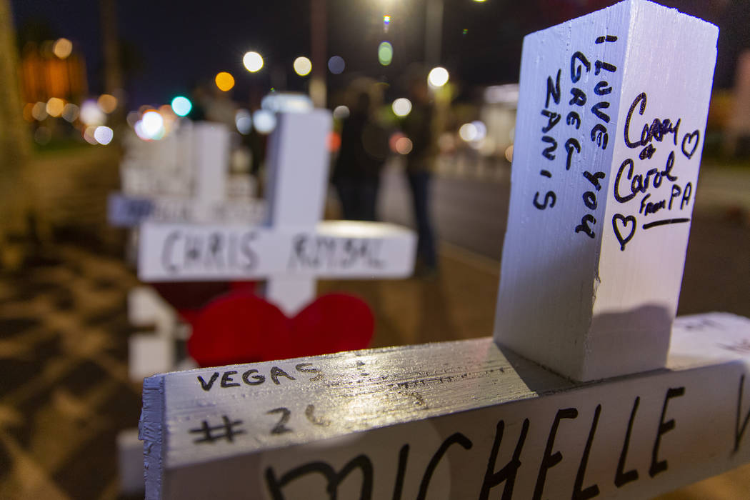 "Message on a cross to Greg Zanis who placed 58 crosses near the ""Welcome to Fabulous Las Vegas"" ..."