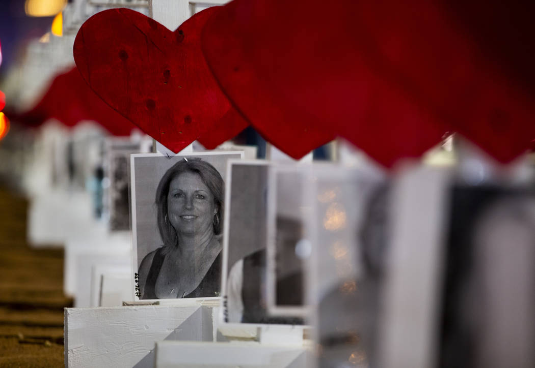 A photo of victim Dana Gardner joins the others on the 58 crosses placed by Greg Zanis near the ...