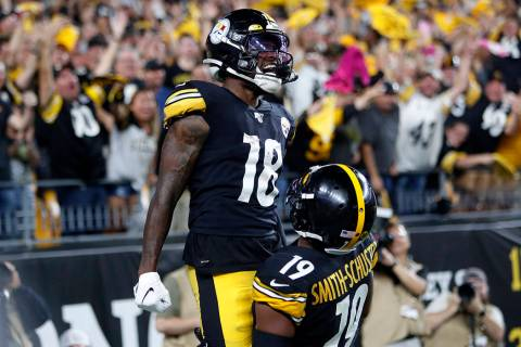 Pittsburgh Steelers wide receiver Diontae Johnson (18) celebrates with JuJu Smith-Schuster (19) ...