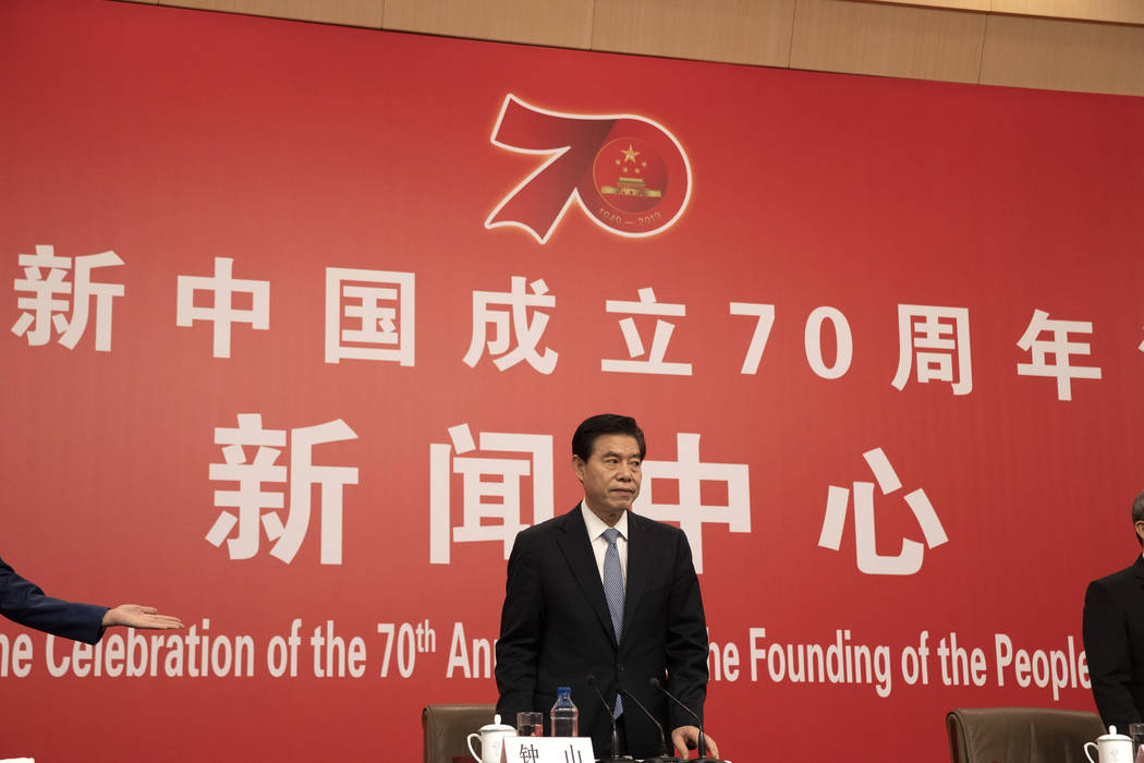 Chinese Commerce Minister Zhong Shan arrives for a press conference on the sidelines of the upc ...