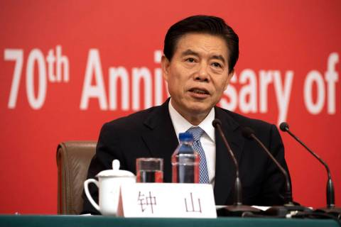 Chinese Commerce Minister Zhong Shan speaks during a press conference on the sidelines of the u ...