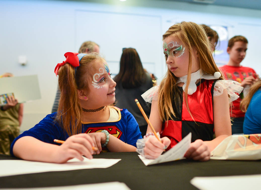 Izabella, left, and Dalayla, right, both eight, make drawings during at the 11th annual Vegas V ...