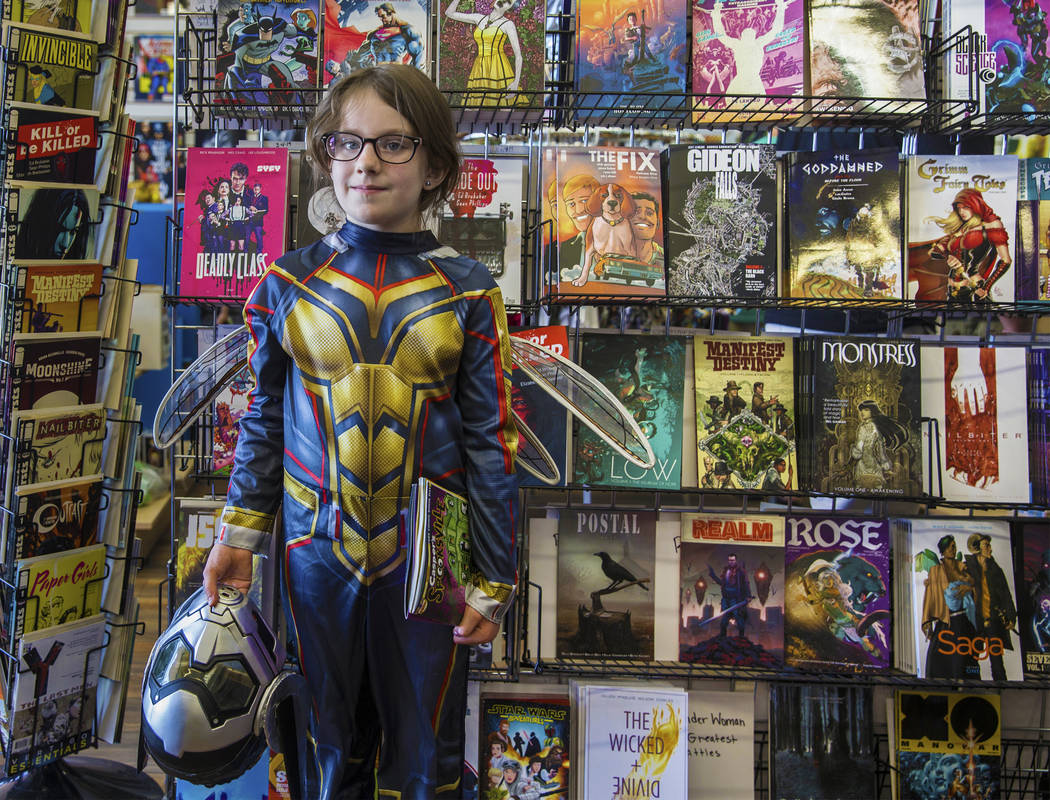 Emma Lee, 8, dressed as The Wasp, during free comic book day at Cosmic Comics on Saturday, May, ...