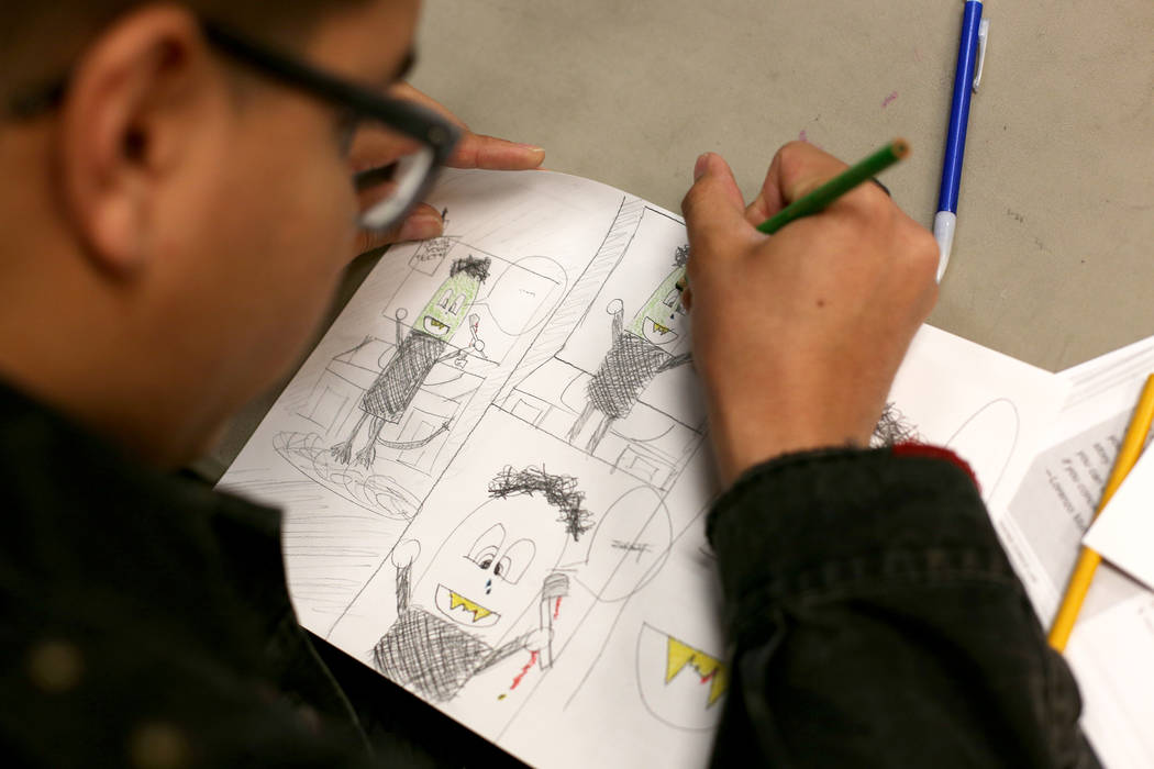 Rodrigo Blotte draws a comic at the class of the Maximum League of Aspiring Artists at Maximum ...