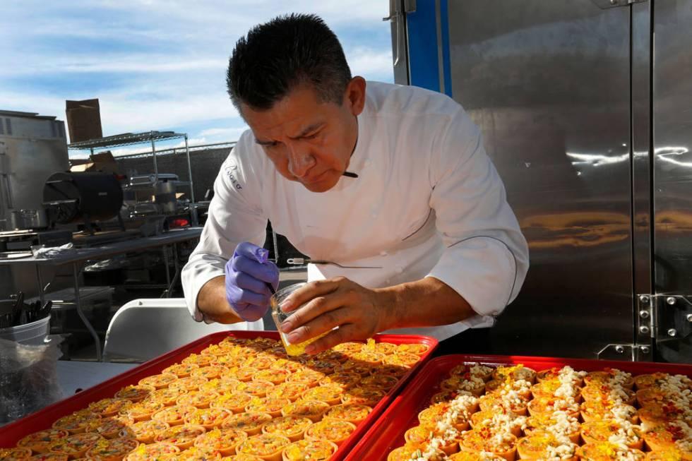 Le Cirque Chef Noe Loyola prepares samples during a food event, Martha Stewart Wine & Food ...