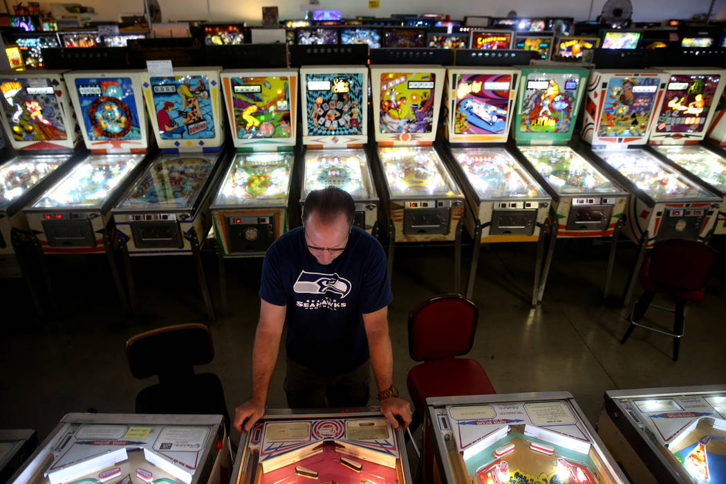 Norm Dunn of Costa Rica plays a pinball machine at the Pinball Hall of Fame at 1610 E. Tropican ...