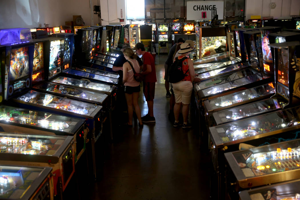 People play pinball machines at the Pinball Hall of Fame at 1610 E. Tropicana Ave. in Las Vegas ...
